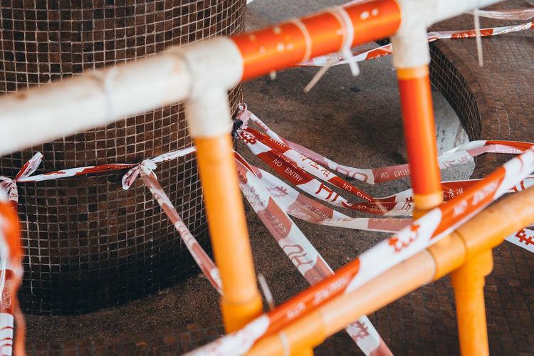 Close-up of orange plastic pipes