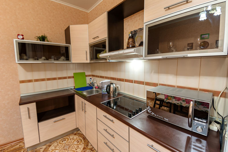 Kitchen Domestic Room Domestic Kitchen Home Kitchen Counter Household Equipment Indoors  Sink Home Interior Appliance Faucet Furniture Home Showcase Interior Modern Architecture No People Luxury Cabinet Stove Flooring Oven
