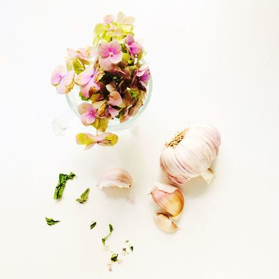 Freshness Studio Shot Indoors  Still Life White Background Flower Flowering Plant Garlic Plant Food Close-up Beauty In Nature Ingredient Spice Choice Nature Food And Drink No People High Angle View Wellbeing Autumn Mood