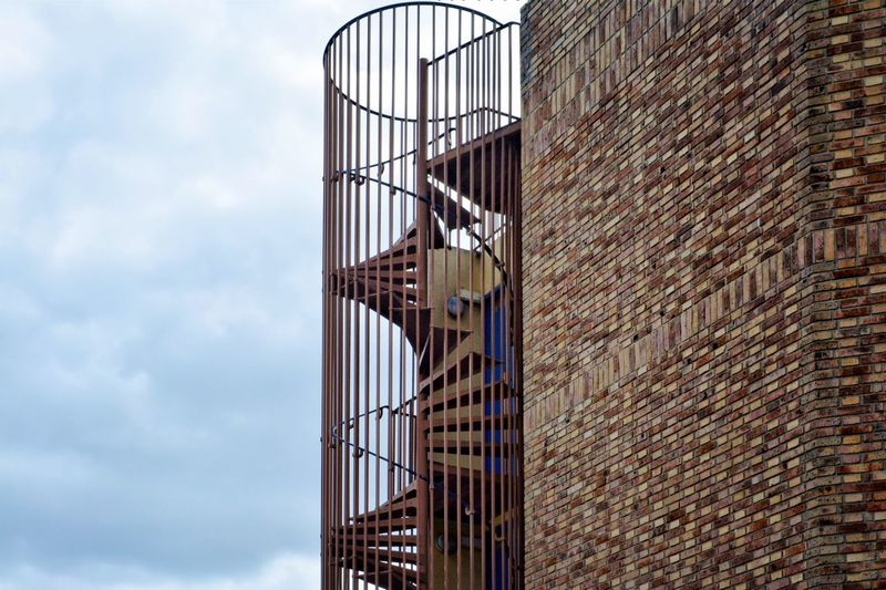 Built Structure Architecture Sky Building Exterior No People Low Angle View Cloud - Sky Day Metal Building Outdoors Protection Pattern Brick Shape Brick Wall
