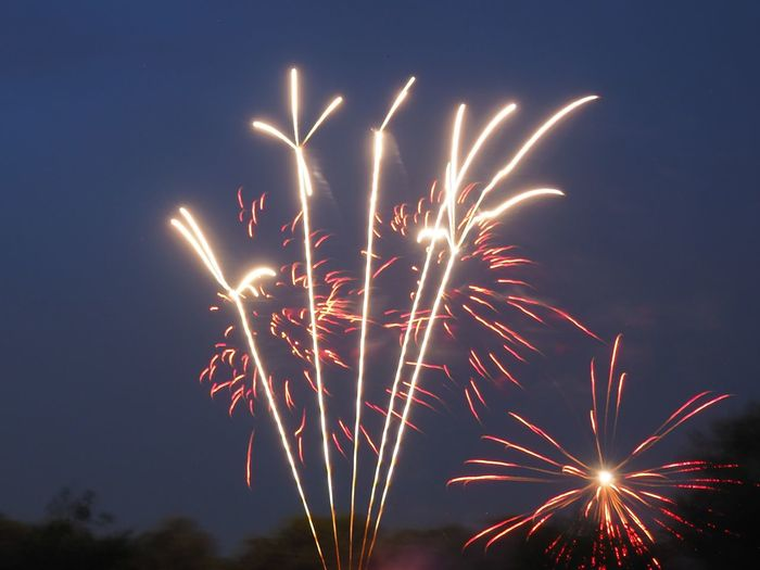 Sky illumed with fire crackers against clear blue sky