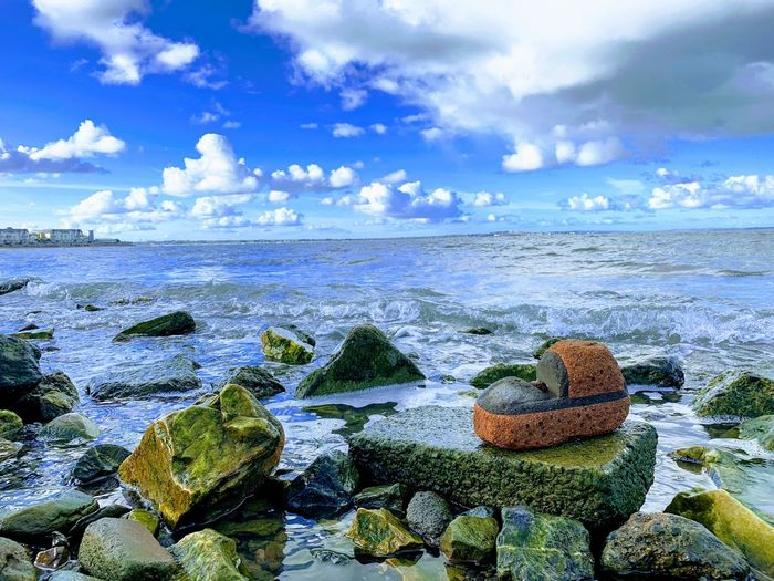 Rock Boots Boots Cloud - Sky Water Sky Sea Tranquility Beach Beauty In Nature Scenics - Nature Tranquil Scene Nature Land Rock Horizon Solid Horizon Over Water Day Rock - Object No People Outdoors