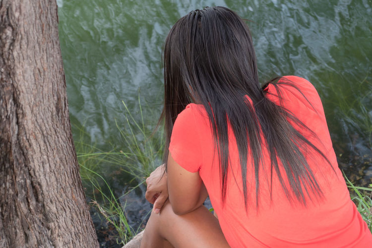 Rear view of woman in lake