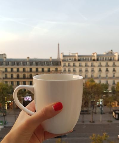 Good morning you beautiful city Human Hand Human Body Part Food And Drink Holding Coffee - Drink Refreshment Building Exterior Architecture EyeEm Best Shots The Week On EyeEm Eiffel Tower Cityscape Travelling Leisure Activity Cup Windows Tourism Good Morning Autumn Female Hand Starting The Day Houses Rooftops No People Paris Stories From The City
