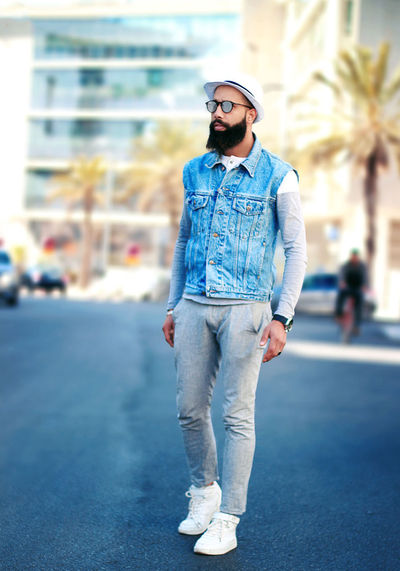 Young Adult Casual Clothing One Person Front View Glasses Standing Fashion Full Length Focus On Foreground Young Men Sunglasses City Looking Away Leisure Activity Lifestyles Real People Day Portrait Jeans Outdoors Hairstyle Fashion Fashion Photography Fashion Model