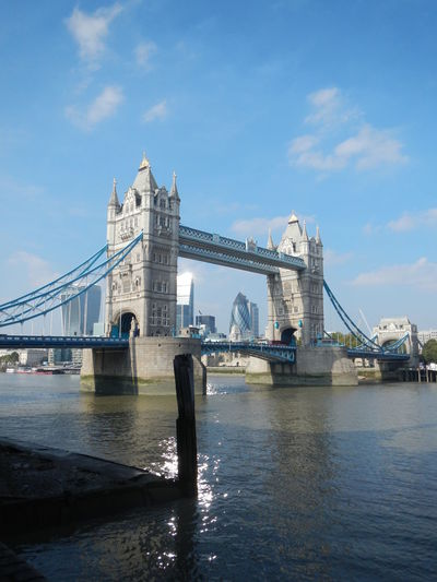 Tower bridge over thames river against sky in city