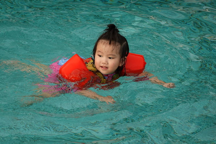 Portrait of cute boy in swimming pool