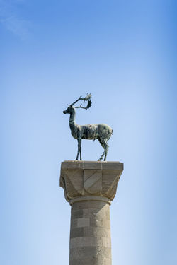 The Rhodes deer at the entrance to Mandraki Harbour, Rhodes, Greece, showing where the Colossus is alleged to have stood Mandraki Harbour Rhodes Greece Rhodes Deer Rhodes Harbour Architecture Day History Low Angle View No People Outdoors Sculpture Statue Travel Destinations