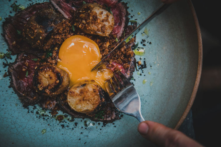 Human Hand Human Body Part Hand Food Food And Drink Holding Kitchen Utensil One Person Freshness Real People Eating Utensil Healthy Eating High Angle View Wellbeing Indoors  Egg Close-up Egg Yolk Preparation  Preparing Food Finger Breakfast