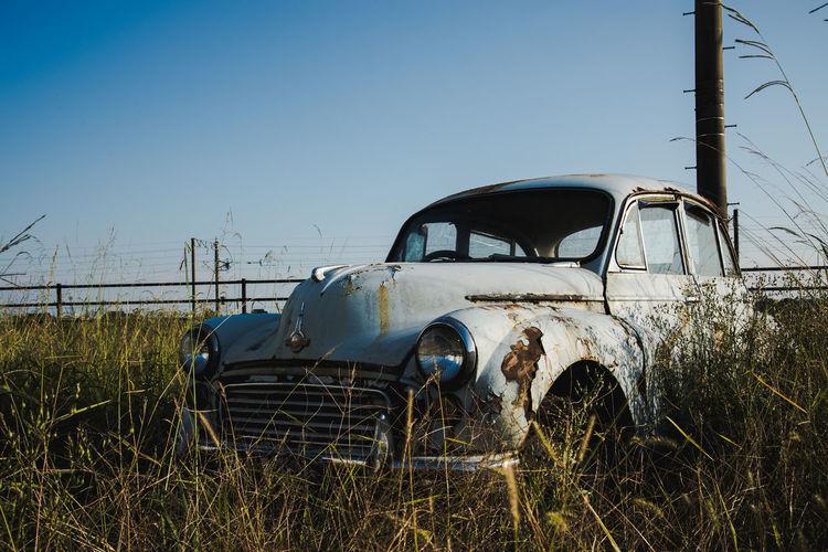 Abandoned car on landscape