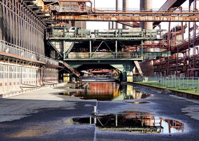 The Architect - 2016 EyeEm Awards Architecture Architectural Detail Urban Urban Geometry Urbanphotography Colors Colorful Eyeem Ruhrgebiet Oficial Photo Club📷🔨🔧🚣🚟🚛 Worldheritage Zeche Zollverein Check This Out Puddle Rust Rusty Steel EyeEm Best Shots From My Point Of View Ruhrgebiet Color Reflection Reflections