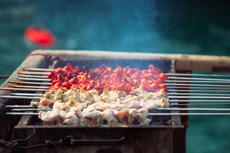 Heat - Temperature Barbecue Barbecue Grill Food Meat Smoke - Physical Structure Food And Drink Preparation  Grilled Burning Freshness Skewer Fire Fire - Natural Phenomenon Preparing Food No People Kitchen Utensil Day Flame Steam Outdoors Snack Street Food Kebab