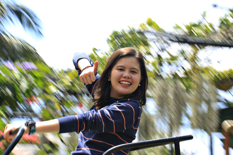 Gillian on a seesaw Backgroundblur Euphoria Excitement Freeze Shots Fun Leisure Activity Lifestyles Outdoors Portrait Seesaw Tree
