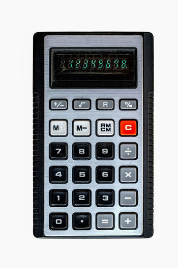 Old pocket calculator Algebra Business Calculator Close-up Cut Out Dividing Electronics Industry Finance Keypad Mathematics No People Number Push Button Science Solar Energy Solar Panel Technology White Background