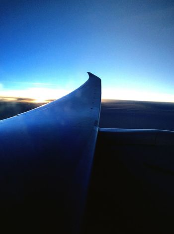 Sunrise New York Taking Off Taking Photos From The Plane Window From The Airplane Window Dreamliner From An Airplane Window Photography In Motion AirPlane ✈ Airplane Wing Blue Wave
