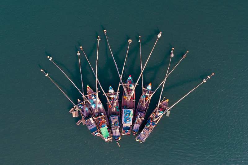 Ha Long Bay Bai Tu Long Bay Large Group Of Objects High Angle View No People Water Sea Nature Transportation Nautical Vessel Abundance Day Outdoors Waterfront Collection Multi Colored Mode Of Transportation Close-up Choice Variation Boat Vietnam Halong Bay Vietnam