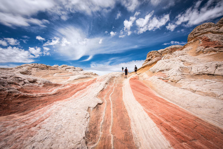 White Pockets in The Vermillion Cliffs National Monument is truly otherworldly. The brain rock and waves of sandstone create one of the most unique terrains imaginable. White Pocket, Arizona Activity Arid Climate Beauty In Nature Climate Cloud - Sky Day Environment Land Landscape Leisure Activity Lifestyles Mountain Nature Non-urban Scene One Person Outdoors Real People Rear View Scenics - Nature Sky Tranquil Scene Tranquility The Great Outdoors - 2018 EyeEm Awards