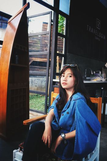 Chill Real People Young Adult One Person Young Women Black Hair Long Hair Window Lifestyles People Human Hand Coffee Time Chilling Coffeshop