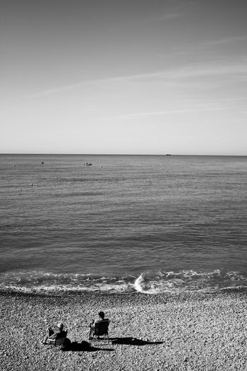 Sea Horizon Over Water Beach Outdoors Sand No People Nature Tranquility Day Sky Water Scenics Beauty In Nature Live For The Story People Silhouette Black And White Photography Bw_lover Bwcollection The Street Photographer - 2017 EyeEm Awards EyeEmNewHere Neighborhood Map Leisure Activity Adult Sun Hat