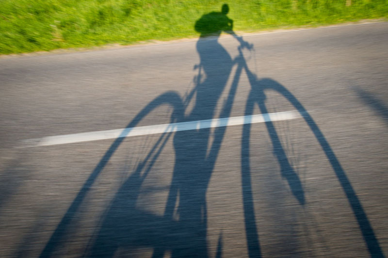 Abnormal Wheels Adult Byke Byking Cycling Cyclist Day Lonely Man On The Road Man On The Byke One Man Only One Person Outdoors Shadow Shadow Byker And Byke Shadow Of Wheels Sport Two Wheels Water