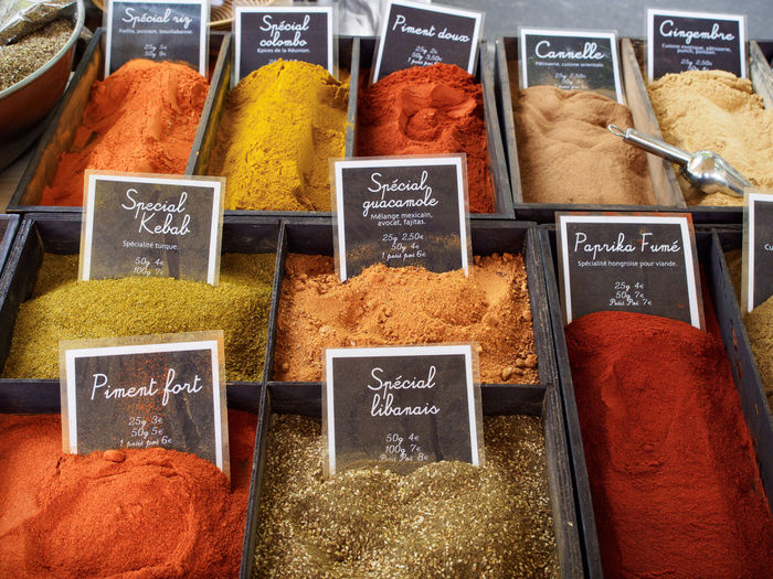 Variety Of Spices For Sale At Market Stall