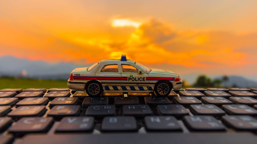 Close-up of toy car against sky during sunset