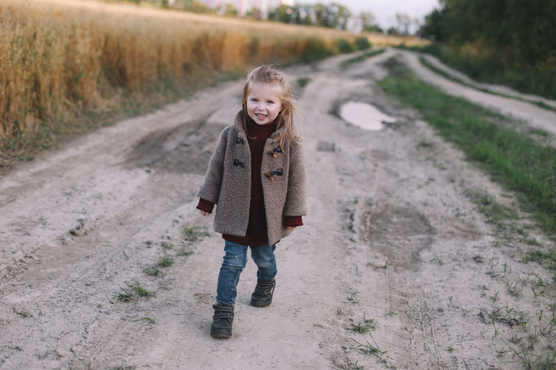 Portrait of girl standing on road