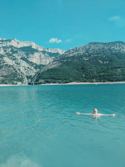 Man relaxing in clear blue lake Alone Alone Time Solitude Solitary Meditation Floating Provence Lac Sainte Croix Zen Minimalism Man Relaxing Relaxation Vacation Blue Blue Water Peace Peaceful Water Mountain Tree Lake Sky Hiker Swimming Floating In Water EyeEmNewHere