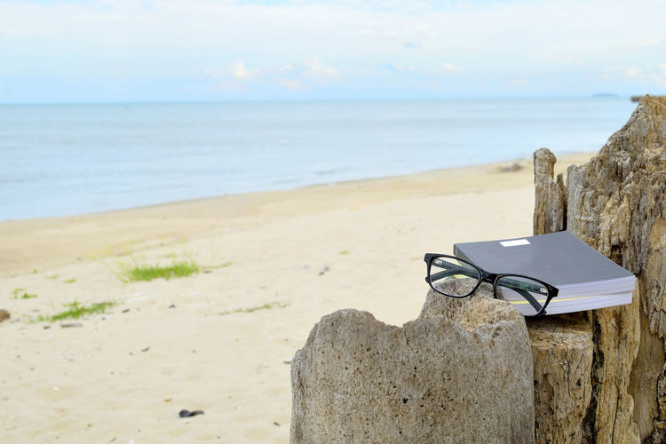 Chill Out Learning Nature Read Reading Relaxing Work Working Beach Beauty In Nature Close-up Day Learn Nature No People Outdoor Outdoors Relax Relaxation Sand Sea Sky Summer Tranquility Water