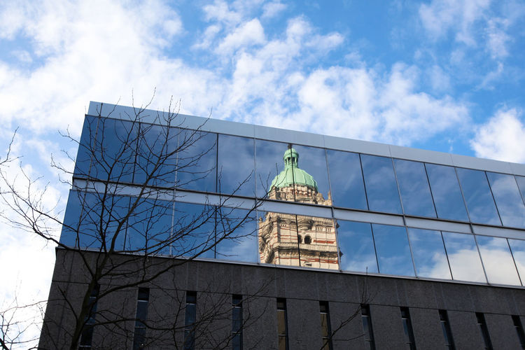 Queen's tower reflection, Imperial College London Imperial College London London Mirror Reflection Sunny The Architect - 2018 EyeEm Awards Winter Architecture Art And Craft Building Building Exterior Built Structure City Cloud - Sky Day Glass - Material Low Angle View No People Office Building Exterior Outdoors Sculpture Sky Tower Tree Window