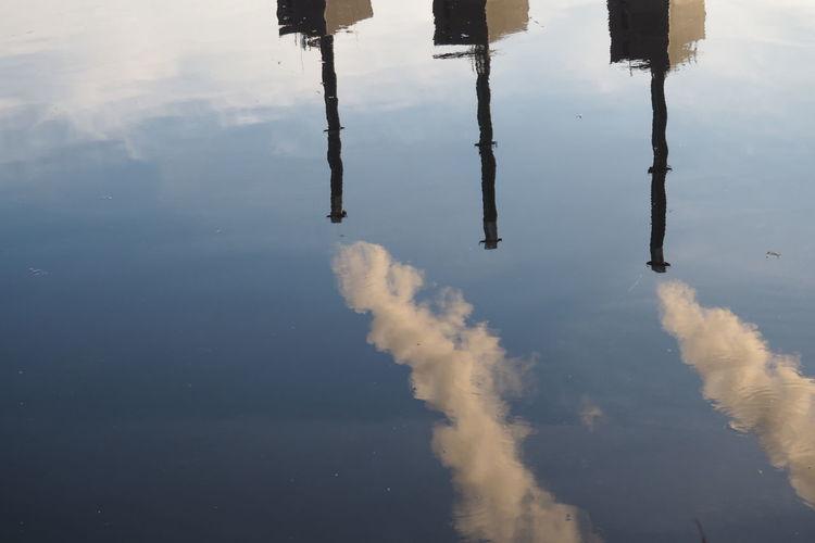 Reflection Of Smoke Stack On Lake