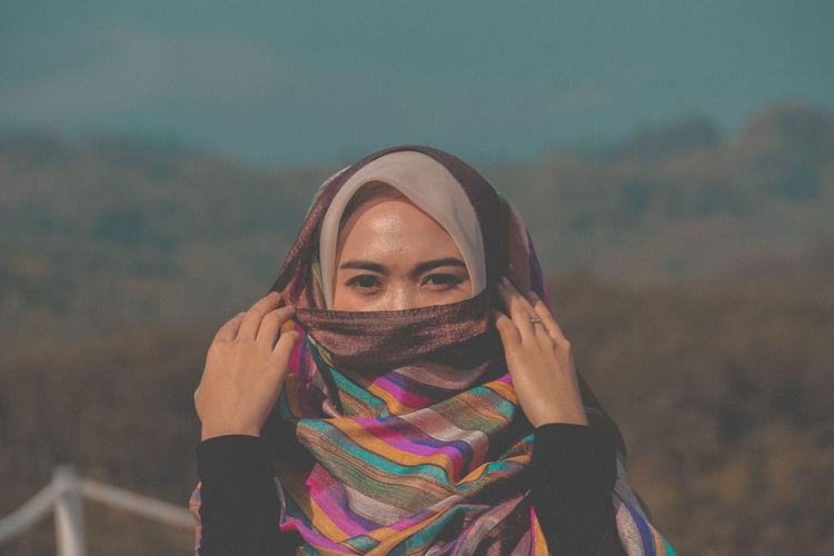 Portrait of beautiful woman wearing headscarf