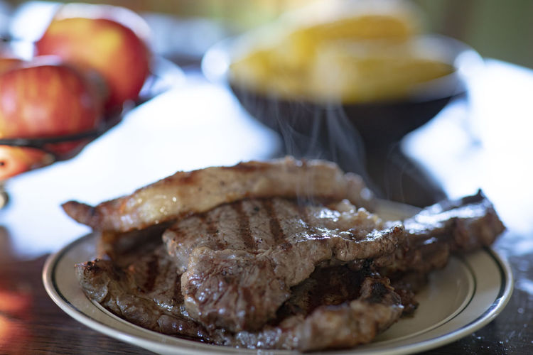 Food Food And Drink Freshness Ready-to-eat Meat Plate Table Close-up Still Life Focus On Foreground Wellbeing Indoors  Healthy Eating No People Indulgence Selective Focus Serving Size Temptation Dinner Steak Ribeye Ribeye Steak Grilled Grilled Meat Corn Corn On The Cob Apples Dinner Dinner Time Inside Natural Light 85mm F1.4 Lens