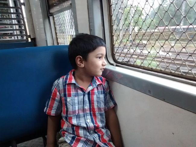 Toddler travelling in train Window Casual Clothing Day Kid Travel Train Window Seat Travel Alone Enjoying Life Travelling Around The World! Start Early Baby Travel Learn