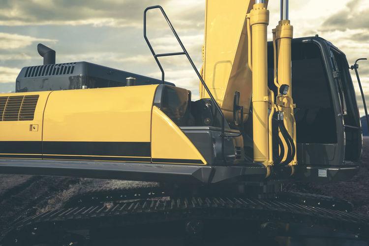 Yellow construction machinery on field