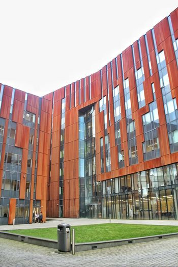Building Exterior Built Structure Architecture Sky Grass Day Metropolitan University Broadcasting Tower Rusty Building Rusted Metal  Rusty Metal Rust Red Pattern Geometric Shape Leeds, UK Pattern, Texture, Shape And Form Windows Architectural Feature EyeEmNewHere Diagonal Lines Glass Low Angle View Courtyard