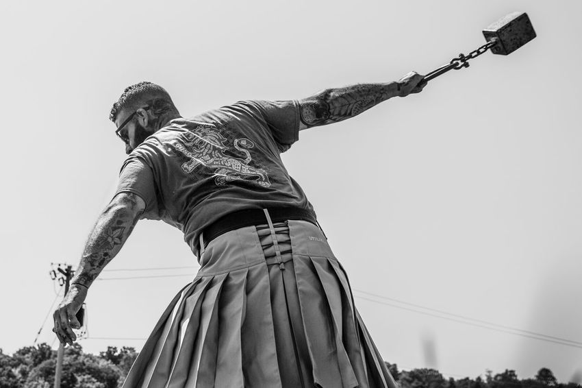 Beard Black & White Black And White Clear Sky Day Hammer Toss Highland Games Kilt Low Angle View Men Muscular Build One Man Only Outdoors People Sky Sunglasses Sword Young Adult