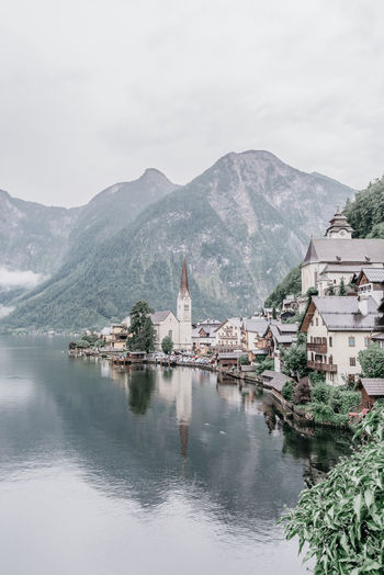 Building Exterior Mountain Architecture Water Sky Building Place Of Worship Religion Day Mountain Range Nature Waterfront Beauty In Nature Plant Outdoors No People Lake Travel Destinations Cold Temperature Reflection Plant Foggy