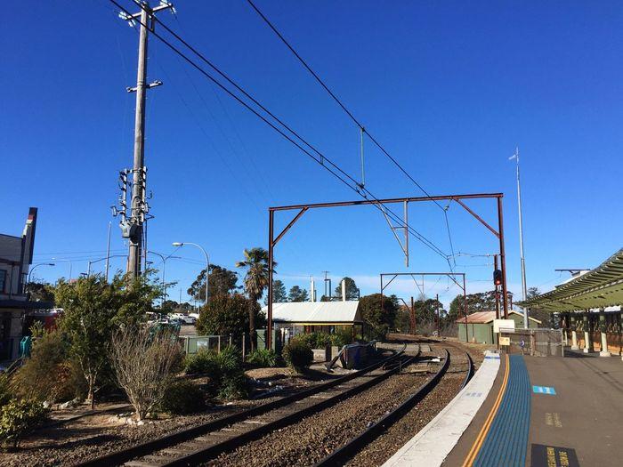 Railroad Tracks Against Blue Sky