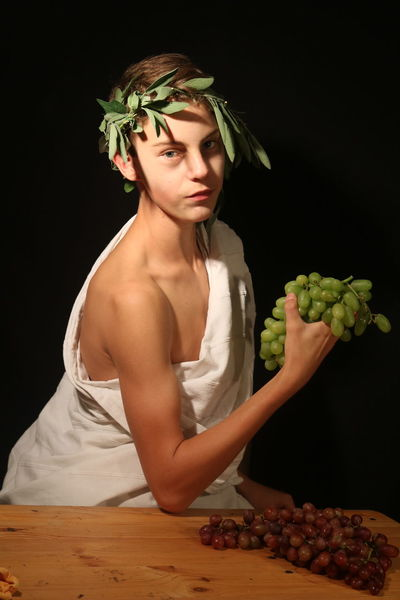 Dionysus (inspired by Cindy Sherman) Bacchus Cindy Sherman God Adult Beauty Black Background Dionysos Dionysus Fashion Food Food And Drink Freshness Front View Fruit Grape Greekmythology Hairstyle Healthy Eating Holding Indoors  One Person Portrait Studio Shot Wellbeing Young Adult The Portraitist - 2018 EyeEm Awards EyeEmNewHere
