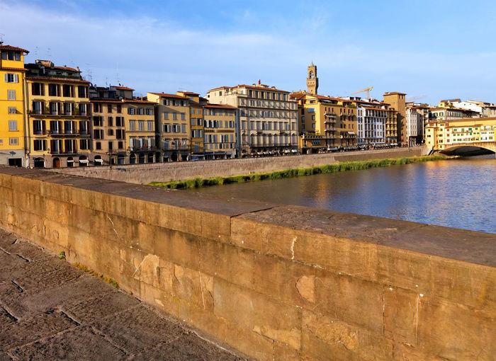 Buildings by arno river seen from ponte santa trinita in tuscany