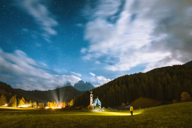 Check out my prints at http://simonmigaj.com/shop/ and visit my IG http://www.instagram.com/simonmigaj for more inspirational photography from around the world. Beautiful night at Santa Maddalena church Sky Cloud - Sky Scenics - Nature Beauty In Nature Tree Nature Night Mountain Star - Space Tranquil Scene Non-urban Scene Environment Landscape Field Real People Men Mountain Range Astronomy Outdoors Santa Maddalena Dolomites Mountains Tranquility Alps Stars