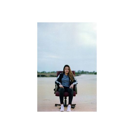 One Person Full Length Sitting Portrait Outdoors Dunes 35mm Film Film Pentax