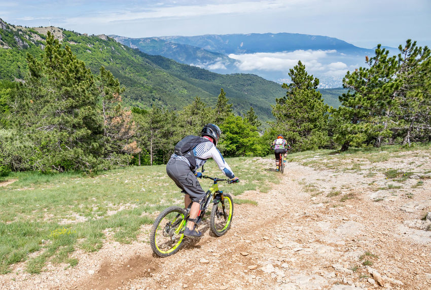 Activity Adventure Beauty In Nature Bicycle Day Full Length Land Vehicle Leisure Activity Lifestyles Men Mountain Mountain Range Nature One Person Plant Real People Ride Riding Sport Transportation Tree