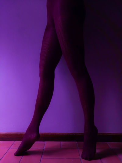 Dancing Woman`s legs wearing purple stockings Ballerina Dancing Pointed Feet Slim Adult Ballet Ballett Barefoot Day Glamour Human Leg Indoors  Low Section One Person People Purple Purple Background Purple Color Real People Standing Studio Shot Woman Legs Young Adult