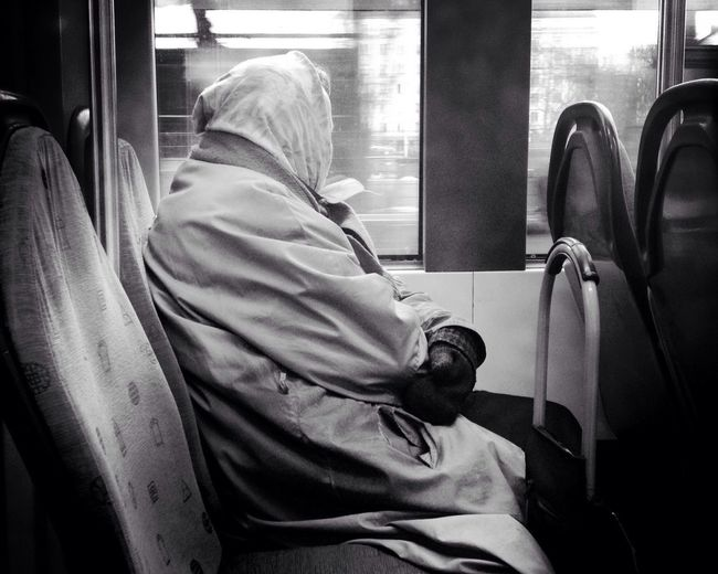 Side view of a woman traveling in bus