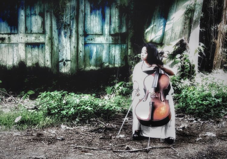 The sounds of strings at abandoned places. Musician Music Cello Cellist One Person Young Adult Outdoors Musical Instrument Architecture Music Outside Abandoned Places Musicians At Abandoned Places Musicians Around The World🎶 Women In Nature Woman In White Dress Woman In Jungle Lost In The Landscape Second Acts One Step Forward Press For Progress Visual Creativity Focus On The Story