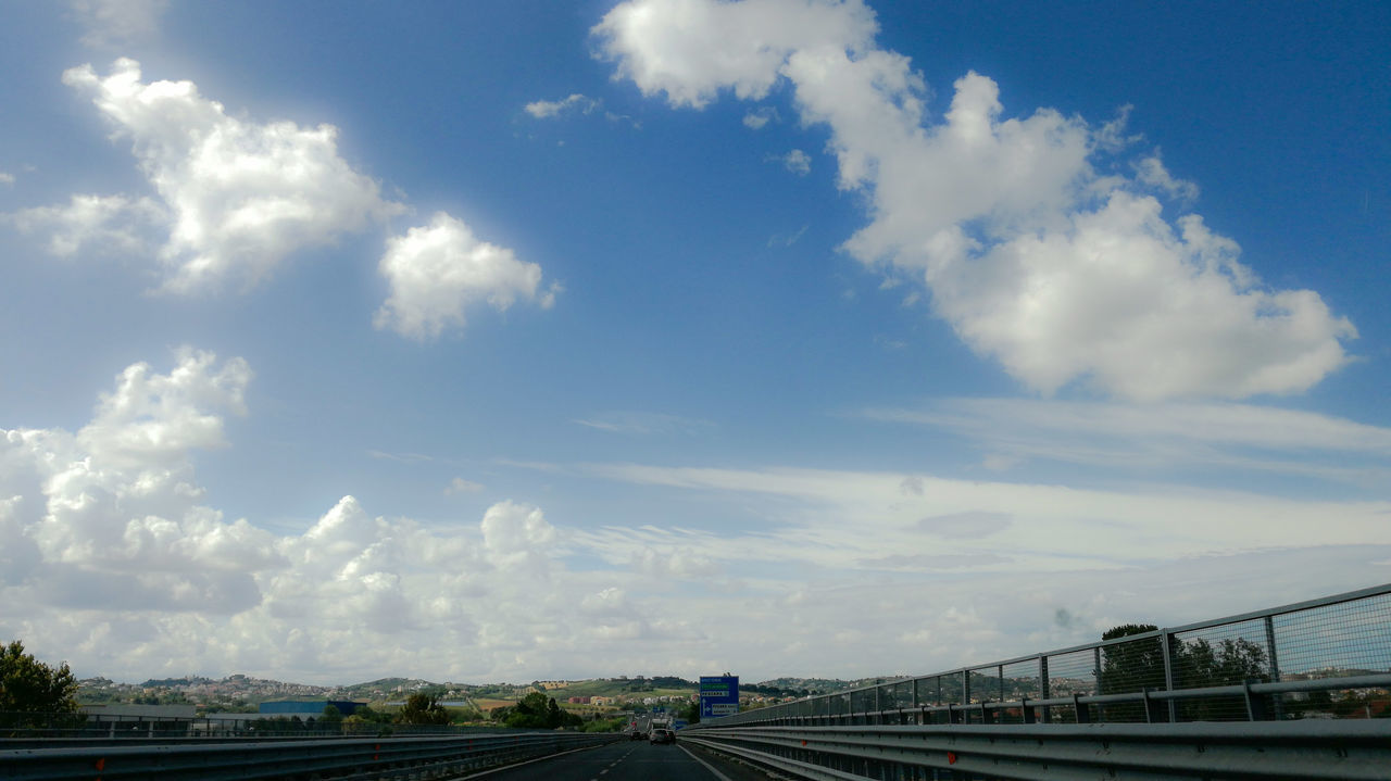 sky, cloud - sky, transportation, day, bridge - man made structure, no people, outdoors, road, architecture, built structure, nature, tree, city