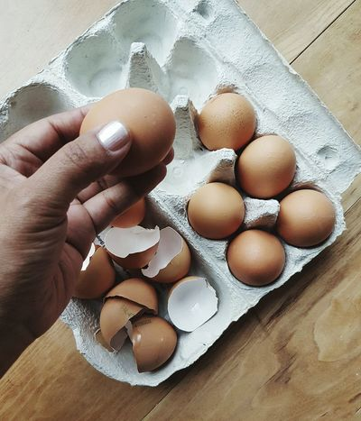 Egg Food Food And Drink Human Hand Indoors  Human Body Part Eggshell Egg Yolk Egg Carton Close-up Freshness Healthy Eating One Person People Picoftheday Easter Ready Easter No People The Week On EyeEm Photooftheday The Weekend On EyeEm Picoftheday Photooftheweek