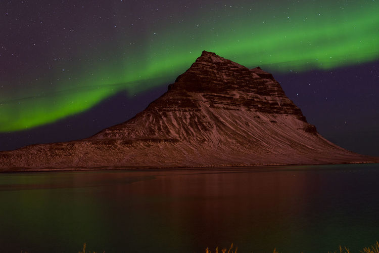 Northern lights behind Kirkjufell mountain, pt. 2 Iceland Kirkjufell Night Scenics - Nature Beauty In Nature Star - Space Waterfront No People Reflection Aurora Borealis Northern Lights Mountain Water Sky Space Astronomy Idyllic EyeEmNewHere